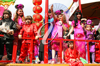 Royalty Free Photo of People Wearing Costumes on a Float