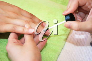Royalty Free Photo of a Woman Getting a Manicure