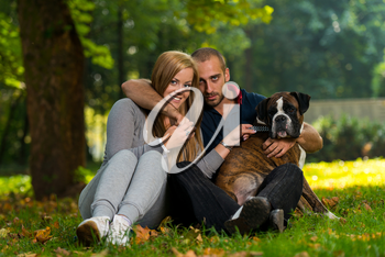 Happy Couple With German Boxer