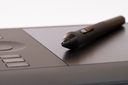 Drawing Tablet With Stylus On White Background
