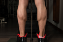 Bodybuilder Doing Heavy Weight Exercise For Legs Calves Close Up