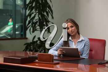 Portrait Of A Young Business Woman Using A Touchpad In The Office - Businesswoman Working Online