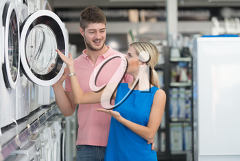 Beautiful Young Couple Shopping For Washing Machine In Produce Department Of A Grocery Store - Supermarket - Shallow Deep Of Field