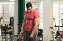 Handsome Young Man Standing Strong in Pink T-shirt and Flexing Muscles - Muscular Athletic Bodybuilder Fitness Model Posing After Exercises