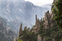 Large Vertical rocks in China's Yellow Mountains with misty sky in background