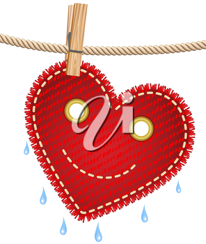 Textile red heart drying on a clothesline