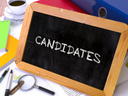 Candidates - Chalkboard with Hand Drawn Text, Stack of Office Folders, Stationery, Reports on Blurred Background. Toned Image. 3D Render.