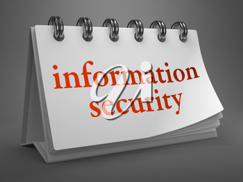 Information Security - Red Words on White Desktop Calendar Isolated on Gray Background.