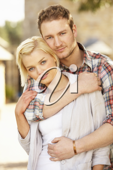 Portrait Of Romantic Young Couple Embracing