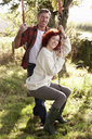 Couple with country garden swing