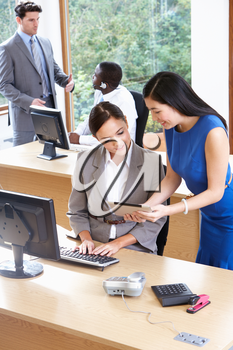 Businessmen And Businesswomen Working In Busy Office