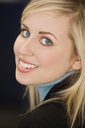 Studio shot of a smartly dressed, beautiful, blond haired blue eyed female model
