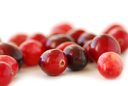 Fresh red cranberries macro on white background