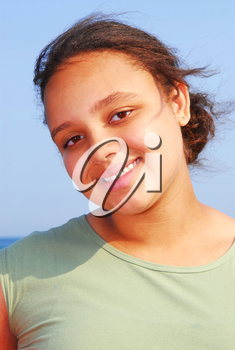 Portrait of a beautiful young girl on sea shore on a breezy day