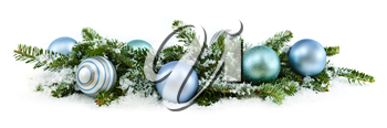 Many Christmas decorations laying in pine branches and snow