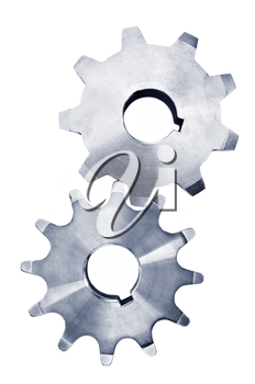 Interlocking industrial metal gears isolated on white