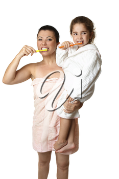 A mother and  her young daughter brushing their teeth .