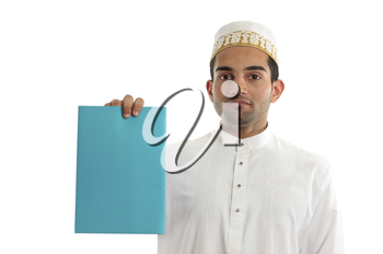 An ethnic mixed race businessman wearing cultural attire is holding a blank document, brochure, advertisement.  White background.