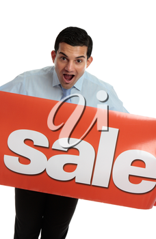 A closeup of an excited business or retail worker holding a red banner sign with Sale written on it.