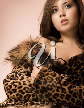 Image of seductive woman in fashionable leopard jacket