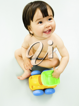 Portrait of little girl with toy car isolated on a white background