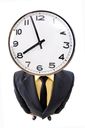 Fish-eye shot of standing businessman with clock on place of head