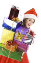 Portrait of smiling young girl carrying heap of presents
