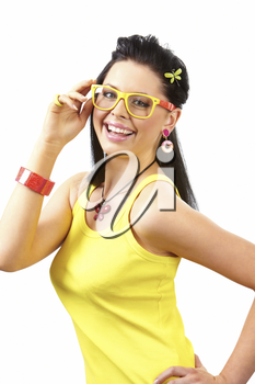 Portrait of charming woman with smile touching her glasses