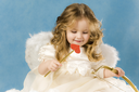 Photo of adorable female cupid holding bow