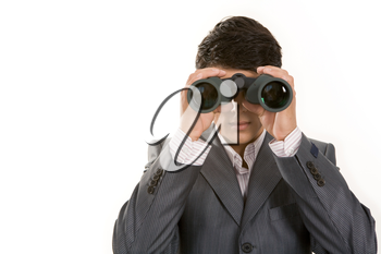 Portrait of confident man in suit observing through binoculars