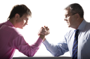 Portrait of two businessmen fighting over white background