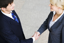 Creative image of people shaking hands making an agreement