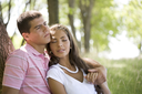 Image of amorous couple having peaceful time in park together