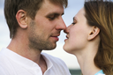 Close-up of happy couple kissing each other