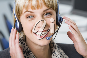 Pretty smiling Customer Support Representative with headset