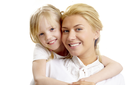Portrait of little girl embracing woman wearing white clothes