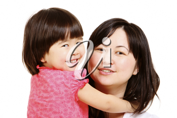 Portrait of mother and small daughter looking at camera