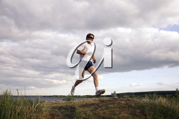 Portrait of sportsman doing exercise in the evening