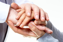 Photo of male and female hands making pile