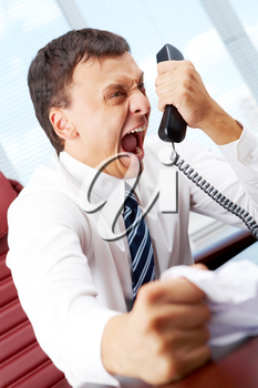 An angry manager screaming in telephone receiver