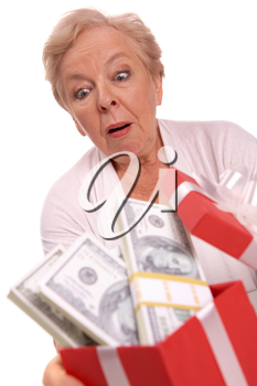 Portrait of surprised female with dollar bills in giftbox looking at it