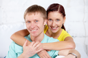 Portrait of happy couple looking at camera