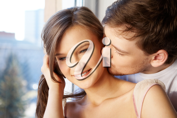 Image of man kissing to girlfriend�s cheek