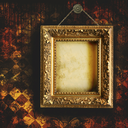 Royalty Free Photo of an Antique Frame on Grungy Wallpaper
