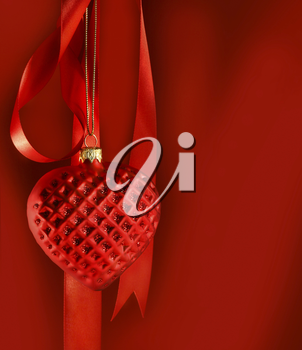 Royalty Free Photo of a Red Heart Hanging From a Red Ribbon on a Red Background
