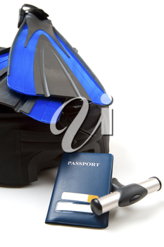 A shot of a luggage, a passport and a pair of flippers, can be used for travel or vacation concept
