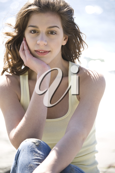 A cheerful beautiful caucasian girl on the beach during summer