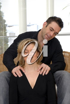 Man giving a massage to his cute blond wife