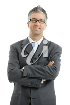 Portrait of businessman wearing gray suit and glasses, standing with arms crossed, smiling.  Isolated on white background.