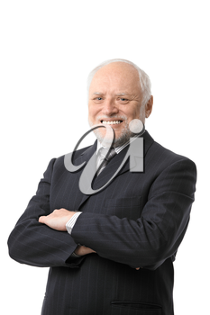 Portrait of happy senior businessman smiling against white background.